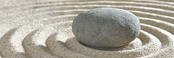 smooth-rock-centered-in circles-sand